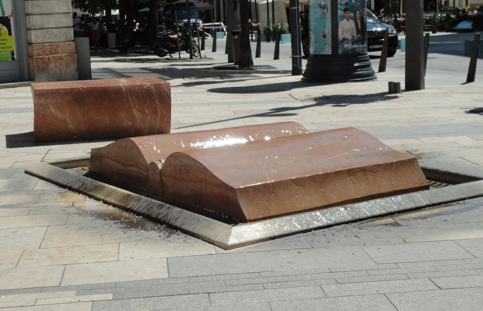 Photo of a fountain shaped like a book with an interesting water effect, located in Budapest, Hungary.