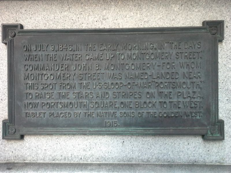 "Photo of a plaque that marks the original shoreline location in San Francisco, California, where Captain John B. Montgomery of the US sloop-of-war ""Portsmouth,"" came ashore to plant the U.S. flag. July 9, 1846."