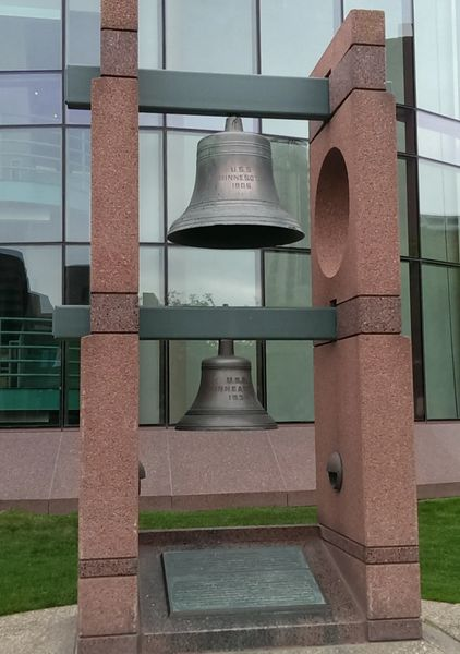Photo of The ship's bells of the battleship USS Minnesota (WWI era) and of the cruiser USS Minneapolis (WWII era), in Minneapolis, Minnesota