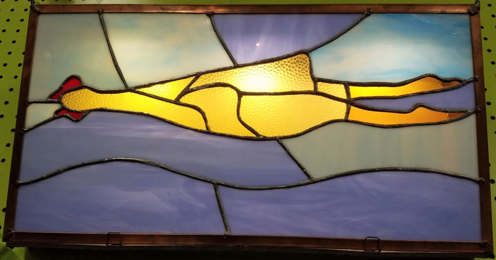 A Photo A stained-glass representation of a rubber chicken in Archie McPhee's world-famous rubber chicken museum in Seattle, Washington