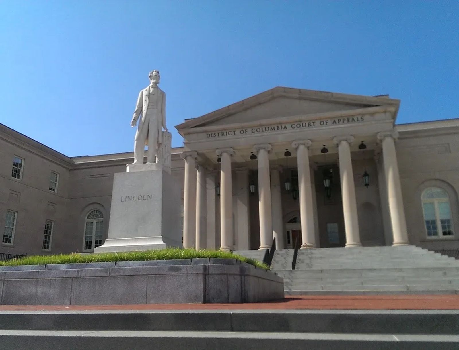 Photo of The statue of Abraham Lincoln, standing in front of the DC Court of Appeals
